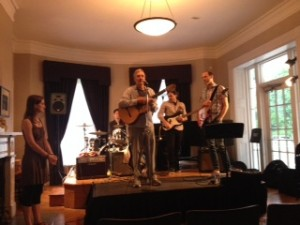 The band performing The Tide Is Turning on June 8th.